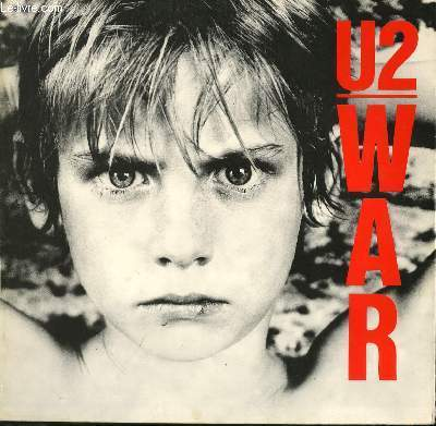 DISQUE VINYLE 33T WAR. SUNDAY BLOODY SUNDAY / SECONDS / NEW YEAR'S DAY / LIKE A SONG / DROWNING MAN / THE REFUGEE / TWO HEARTS BEAT AS ONE / RED LIGHT / SURRENDER / 40.